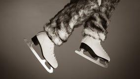 Woman legs wearing ice skates fur socks, skating Royalty Free Stock Image