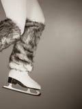 Woman legs wearing ice skates fur socks, skating Royalty Free Stock Photo