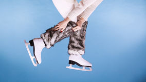 Woman legs wearing ice skates fur socks, skating Stock Photos