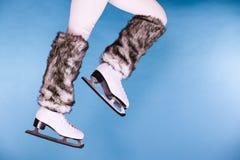 Woman legs wearing ice skates fur socks, skating Royalty Free Stock Images
