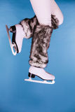 Woman legs wearing ice skates fur socks, skating Royalty Free Stock Photography
