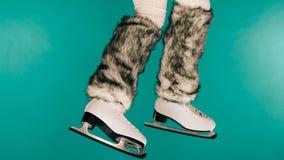 Woman legs wearing ice skates fur socks, skating Stock Image