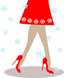 Woman legs wearing red high-heeled shoes and skirt Royalty Free Stock Photography