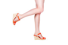 Woman legs wearing of sandals Royalty Free Stock Image