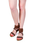 Woman legs wearing of sandals Stock Photo