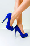Woman legs wearing shoes. Woman legs wearing the blue high heel shoes Royalty Free Stock Photography