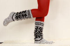 Woman legs wearing woolen socks and red tights Royalty Free Stock Photos