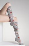 Woman legs in winter socks Royalty Free Stock Image
