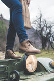 Woman legs with wooden shoes. Woman legs with leather shoes in the forest. Truck Royalty Free Stock Images