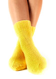 Woman legs in woollen socks stock images