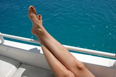 Woman legs on yacht Stock Photo