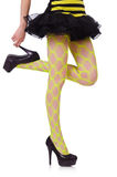 Woman legs in yellow fishnet Stock Photos
