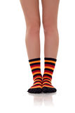 Woman legs in zebrine socks Royalty Free Stock Image