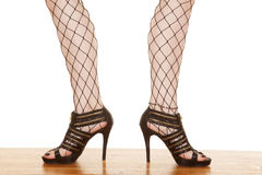 Woman legs zipper shoes net toes out. A woman is standing with her toes point out Royalty Free Stock Photography
