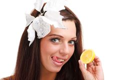 Woman with lemon close up on a white background Royalty Free Stock Photos