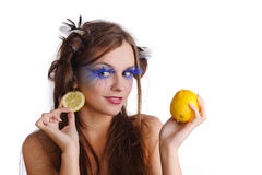 Woman with lemon earring Royalty Free Stock Photos