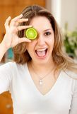 Woman with a lemon in her eye Stock Photography