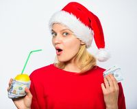 Woman lemon millionaire. Symbol of wealth and prosperity. Source of richness. Richness symbol concept. Rich girl with. Lemon and money. Girl santa hat drink royalty free stock photo