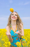 Woman with lemon outside Royalty Free Stock Photos
