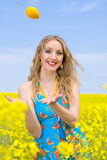 Woman with lemon outside Royalty Free Stock Images