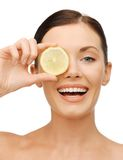 Woman with lemon slice. Bright picture of beautiful woman with lemon slice royalty free stock photos