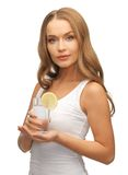 Woman with lemon slice on glass of water Stock Images