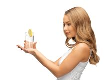 Woman with lemon slice on glass of water Royalty Free Stock Images