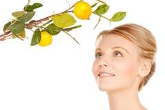 Woman with lemon twig Stock Image