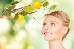 Woman with lemon twig Royalty Free Stock Images