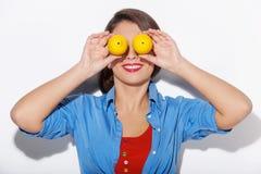 Woman with lemons. Stock Photos