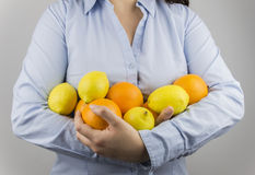 Woman lemons and oranges Stock Images