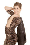 Woman leopard dress jacket over shoulder Stock Photos