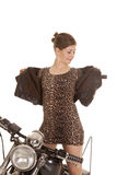 Woman leopard dress jacket stand on motorcycle Stock Image