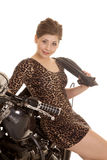 Woman leopard dress motorcycle sit sit smile jacket over shoulde Stock Photos