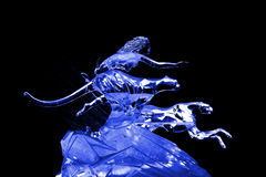 Woman and leopard ice sculpture blue Royalty Free Stock Photography