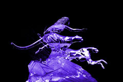 Woman and leopard ice sculpture purple Royalty Free Stock Photos