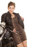 Woman leopard print dress lean on motorcycle smile Stock Photos