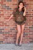 Woman in a leopard print dress Royalty Free Stock Photography