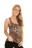 Woman leopard print tank top stand hold bottom of shirt Stock Images