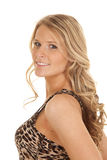 Woman leopard print tank top stand side smile Stock Photography