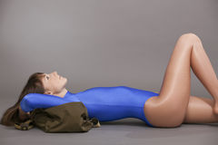 Woman in leotard relaxing on ground Stock Photos