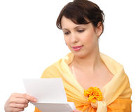 Woman with a letter. On a white background Stock Photography