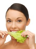 Woman with lettuce Royalty Free Stock Image