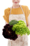 Woman with lettuce, cabbage and broccoli. Royalty Free Stock Image