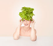 Woman with lettuce on head Stock Image