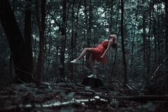 Woman levitating in forest Royalty Free Stock Image