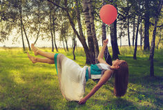 Woman levitating in the forest Royalty Free Stock Image