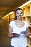 Woman in the library Stock Photo