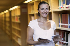 Woman in the library Royalty Free Stock Image