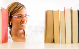 Woman at the library Royalty Free Stock Photos